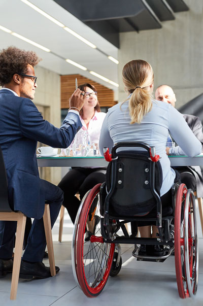 Affiliate meeting at table group person with wheelchair
